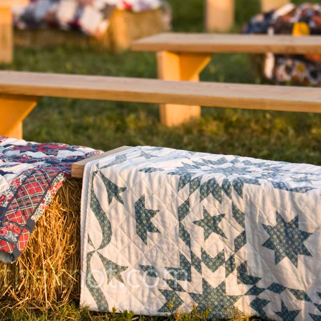 Preston and his dad made more than 20 benches for the ceremony seating, and the couple rented hay bales as well. They topped them all off with quilts.