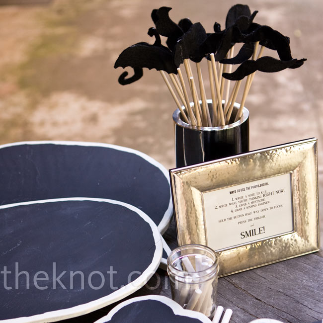 In addition to a traditional guest book, the couple set up a photo booth with a few props. Preston made three chalkboard talk bubbles so guests could write messages.
