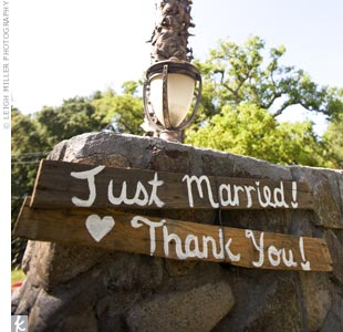 The couple thanked guests for coming with this hand-painted wood sign.