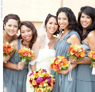 All of the gray chiffon bridesmaid dresses were custom-made in different silhouettes by Laura Bravo.