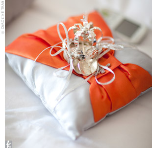The ring bearer carried an orange-and-gray silk pillow handmade by Jo Anne's cousin.