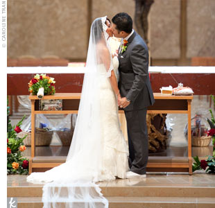 The couple had a traditional Catholic-Filipino wedding mass and simply decorated the altar with a few floral arrangements that matched the bouquets.
