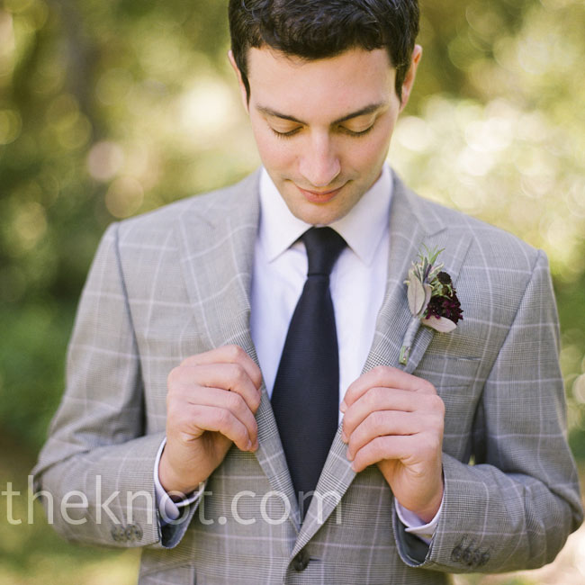 Peter stood out with a deep purple dahlia boutonniere.