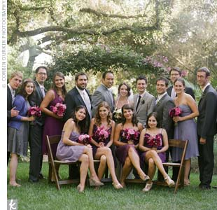 Jessica's bridesmaids wore purple chiffon dresses in various styles, and the groomsmen and bridesman wore gray suits.
