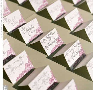 The hand-calligraphed escort cards had the same tree motif as the invitations and were displayed on a table during the cocktail hour.