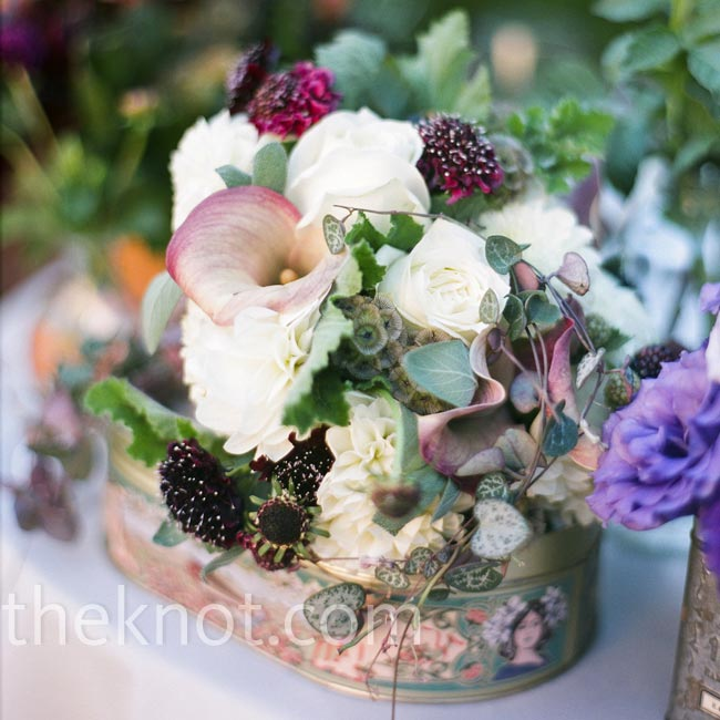 Jessica collected vintage tins to hold the low, jewel-toned centerpieces.
