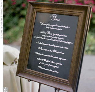 The family-style buffet menu was listed on a framed chalkboard.