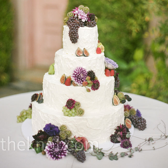 Buttercream frosting and organically placed figs, berries, grapes and flowers gave the cake a rustic look.