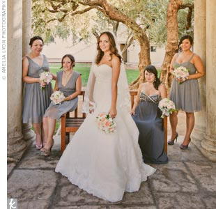 Three of Dina's bridesmaids wore gray dresses from J. Crew, while the fourth found her maternity dress at David's Bridal.