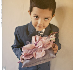The couple's godson, Aidan, carried a pillow Dina made. It was gray and topped with a big fabric flower.