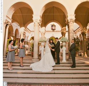 The ceremony took place beneath The Athenaeum's columns and archways. Two pillars of baby's breath marked the altar.