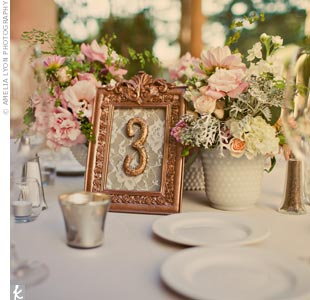 Dina made all of the table numbers from vintage frames. She painted them antique gold, pulled out the glass and wrapped the backs in different fabrics.