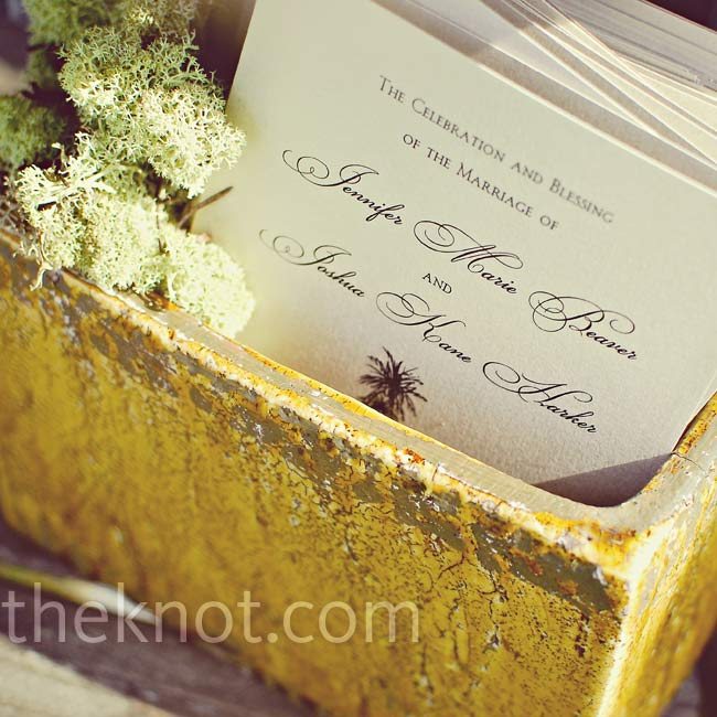 The couple continued their palm tree theme on thick, shimmery cardstock for their wedding programs.