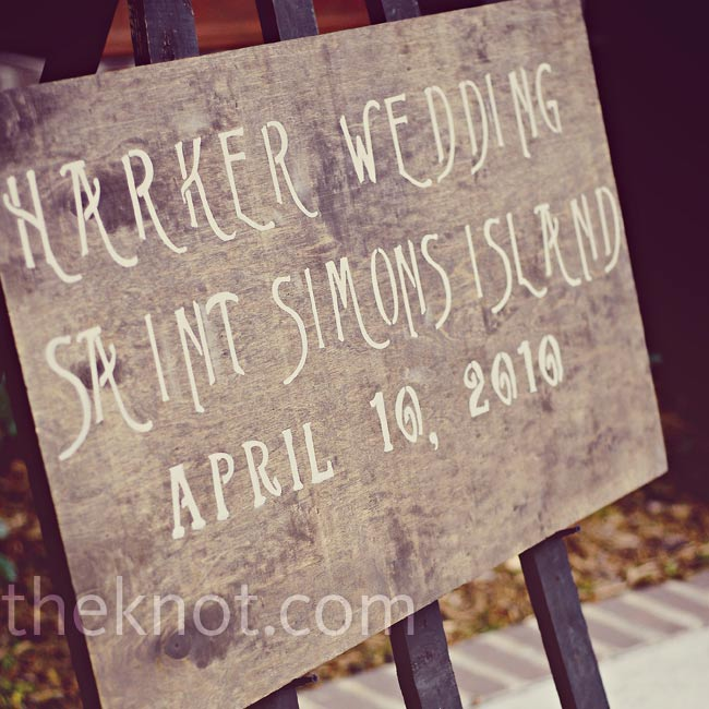A custom wedding sign, propped on an easel, invited guests to Jennifer and Josh's Georgia landmark wedding.