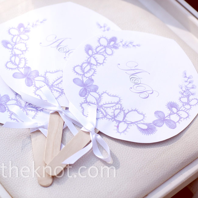 The dual-purpose fan programs were perfect for guests in the warm Georgia sun. An elegant lavender and gray monogram hinted at the palette used throughout the wedding decor.
