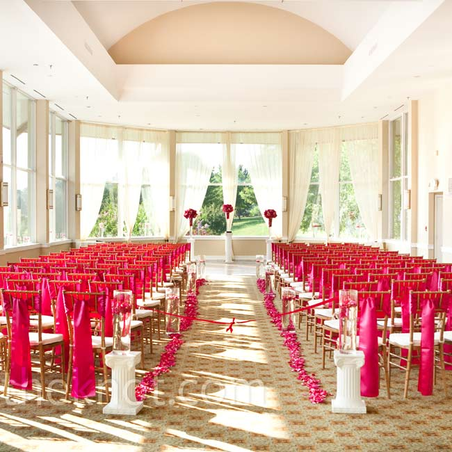 For the ceremony, trails of pink rose petals and tall vessels revealing submerged orchids created the aisle.
