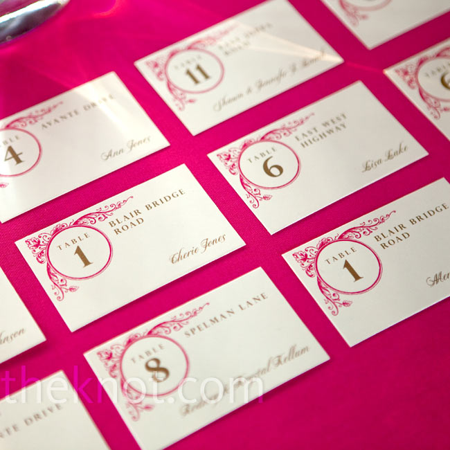 Bright pink scroll patterns tied the escort cards in with the couple's wedding monogram.