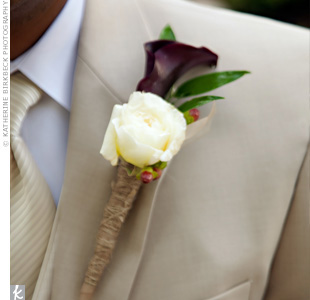 Jason wore a plum calla lily and a white cabbage rose boutonniere with the stems wrapped in burlap.