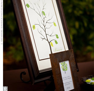 Guests signed small green leaves that were affixed to a framed graphic of a tree. The beautiful keepsake now hangs in the couples home.