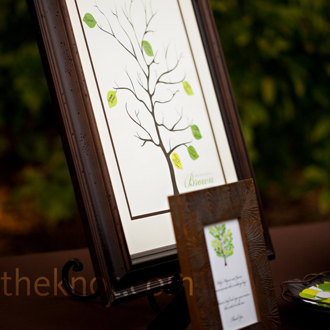 Guests signed small green leaves that were affixed to a framed graphic of a tree. The beautiful keepsake now hangs in the couple's home.