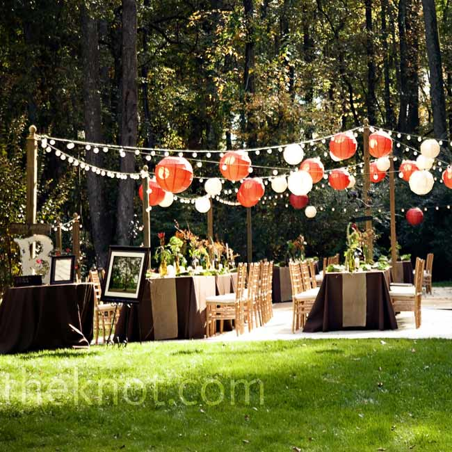 For a moonlit reception they strung lights and colorful lanterns around the reception space and covered the tables in chocolate linens.