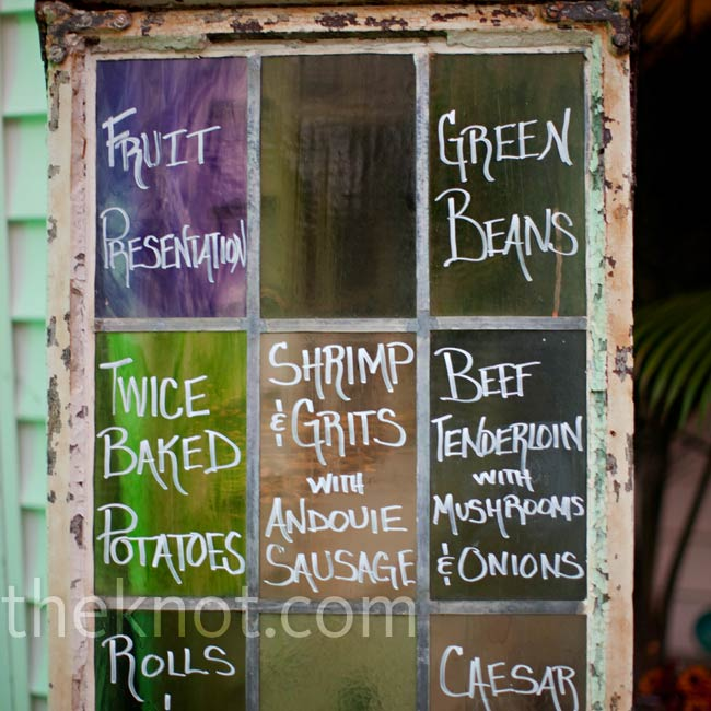 The couple found an antique window and purple and green stained glass panels, perfect for displaying the reception dinner menu.
