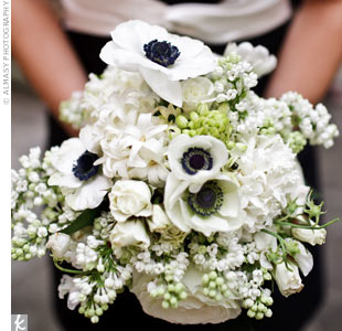 The bridesmaids' bouquets mirrored their black-and-white dresses with anemones of the same color, white roses and stephanotis.