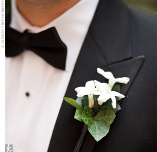 Eric wore a bundle of white stephanotis while his groomsmen wore white rose boutonnieres.