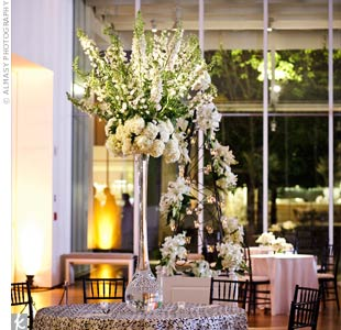 To fill up the large reception space with high ceilings, Eleanor and Eric used six-foot tall arrangements filled with white and green flowers.