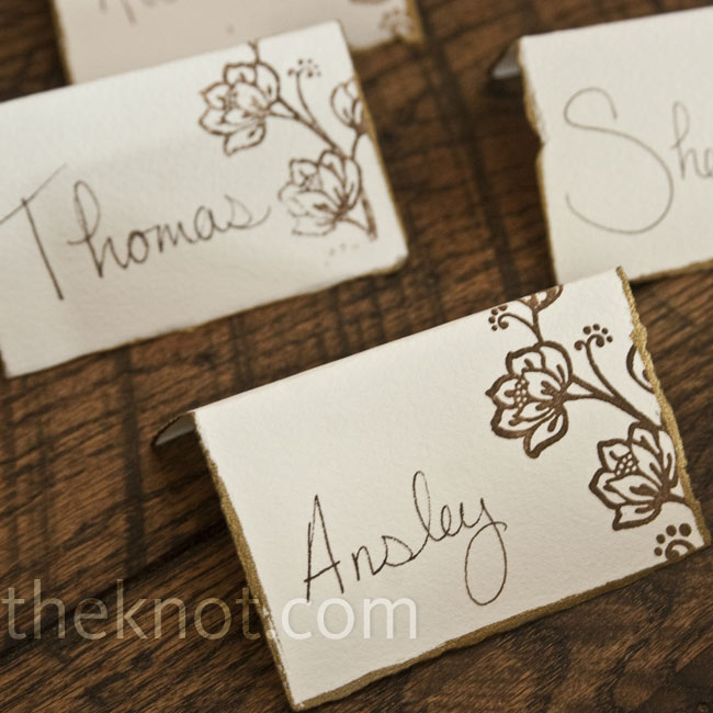 The escort cards were torn from the same watercolor paper used for the invites, and then edged in gold.