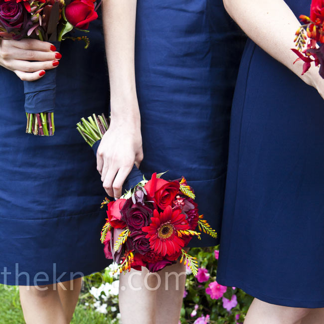 Bouquets of red roses, celosias, dahlias and orchids stood out against the girls' dresses.