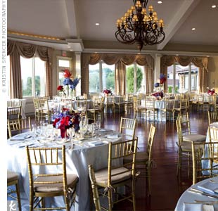 The ballroom's neutral-toned décor worked well with the light blue table linens and red and blue flowers.