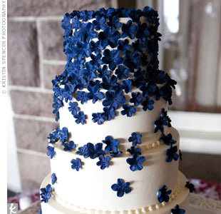Navy-blue sugar flowers cascaded down the tiers.