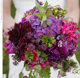 Joyce wanted a bouquet with lots of texture, and her florist delivered with a bursting mix of dahlias, hydrangeas, French ranunculus (her favorite) and fiddlehead ferns.