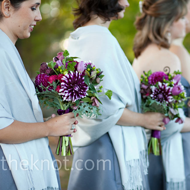 White-tipped purple mums were the stars of these bouquets, which popped against the gray dresses.