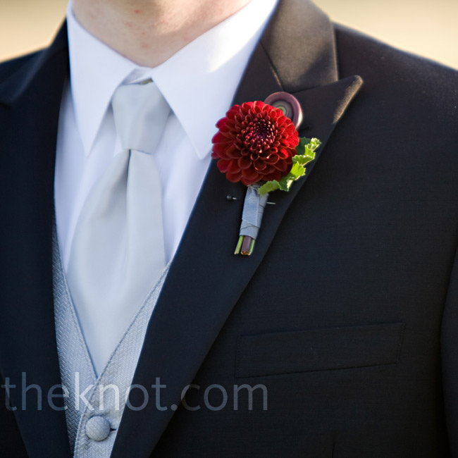 Andrew wore a red pom-pom dahlia and a fiddlehead boutonniere on his lapel.