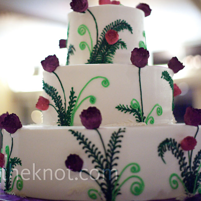 Three-dimensional buttercream flowers and fiddlehead ferns added lots of fun color to the cake.