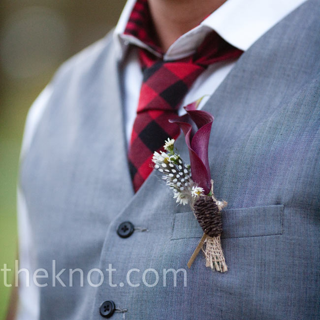 Michael wore a black and red buffalo-plaid tie with a black calla lily and mini daisy boutonniere.