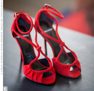 Liana slipped on these red strappy Pierre Hardy heels for the reception.
