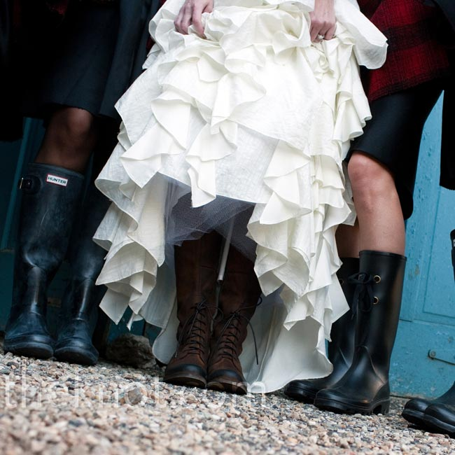 The bridesmaids (and Liana) all wore black Hunter Wellies to the ceremony. It had rained heavily until the night before.