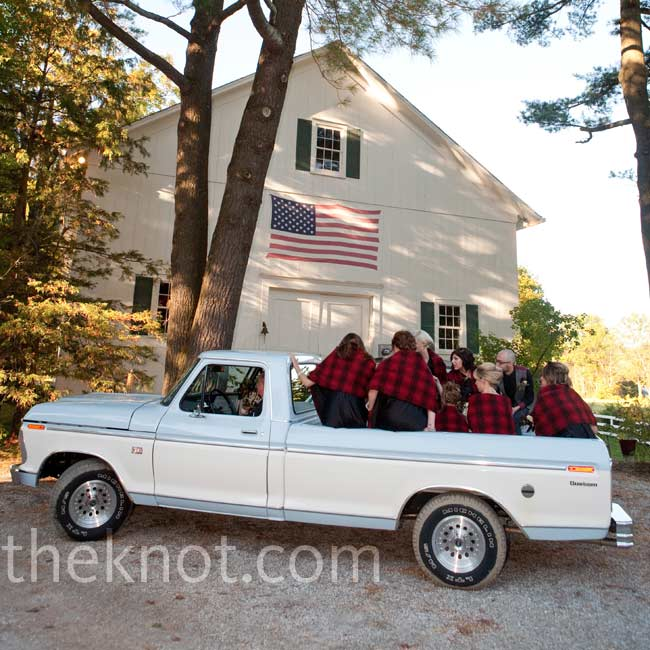 The bridal party rode to the ceremony in a pickup truck.