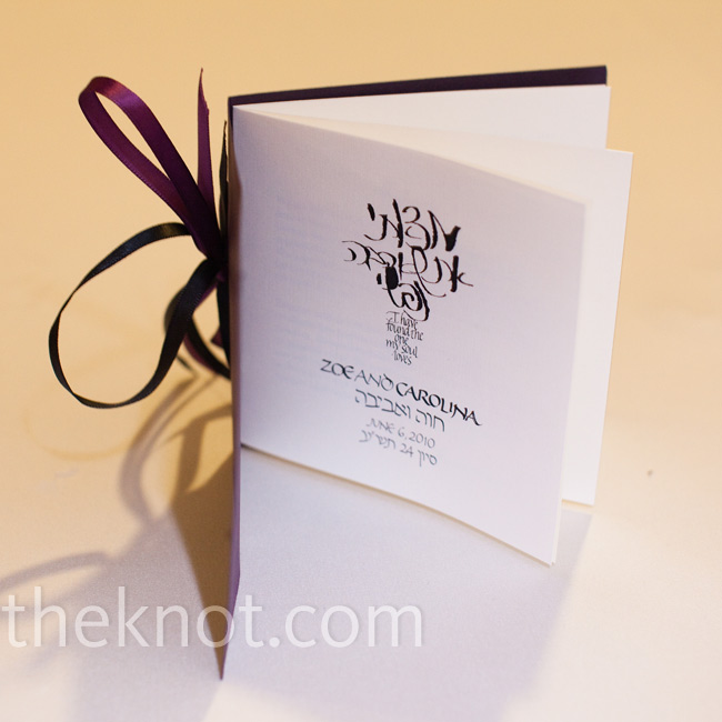 The couple made their own program booklets, which they tied together with purple and black ribbon.