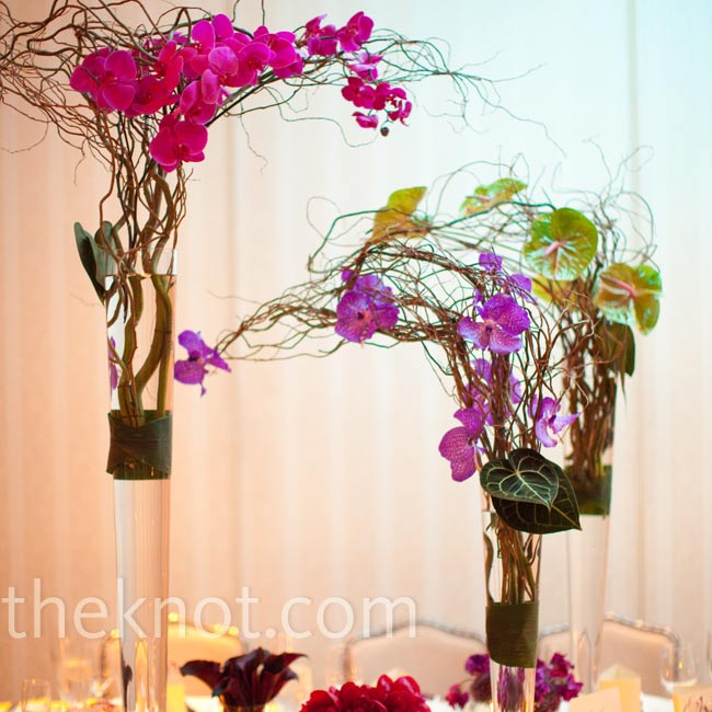 Tall vases filled with curly willow and orchids gave the tables an exotic look.
