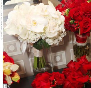 Carissa carried a white bouquet for the ceremony and switched to a red one for the couples grand entrance to the reception.