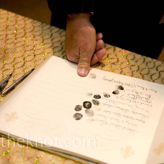 Friends and family signed in and were fingerprinted—a fitting guest book idea.