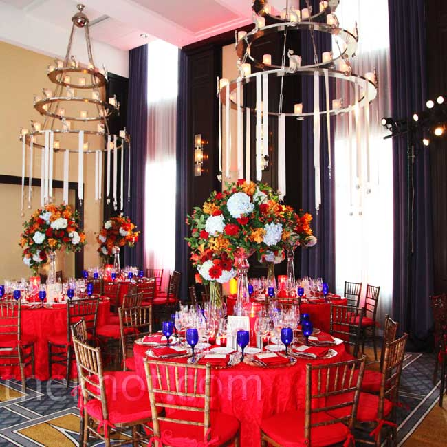 "For a ""red-hot reception,"" the couple had bright-red linens and seat cushions."