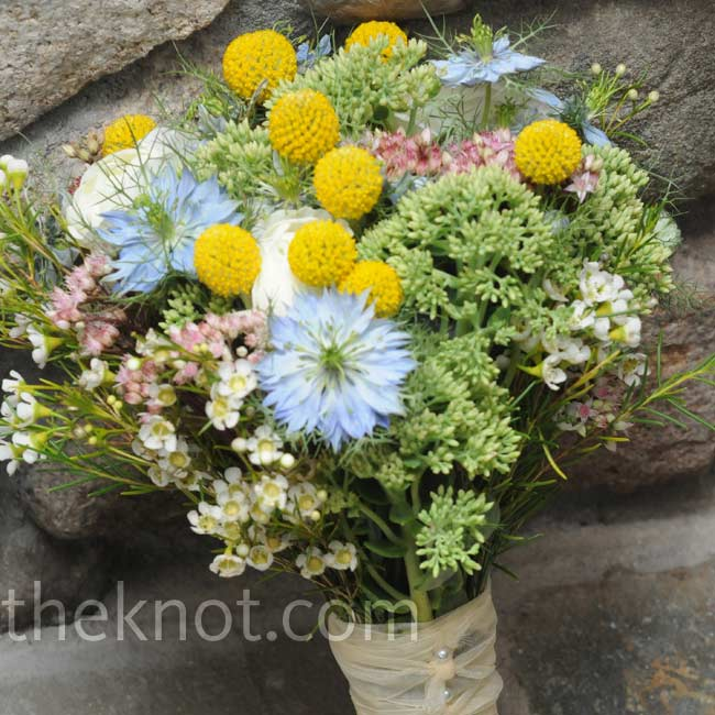 Bright-yellow craspedia added a fun pop of color to Caitlin's laid-back bouquet of wildflowers.