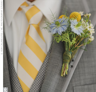 A wildflower and craspedia boutonniere matched Chris's gray suit and striped tie.