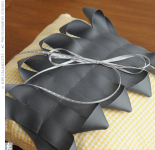 Caitlin designed the ring bearer pillow, which her mom made using yellow fabric and gray ribbon.