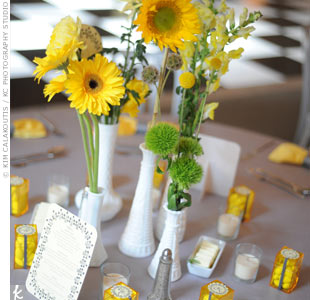Mismatched milk glass vases filled with daisies, craspedia, sunflowers and mums had a low-key look.